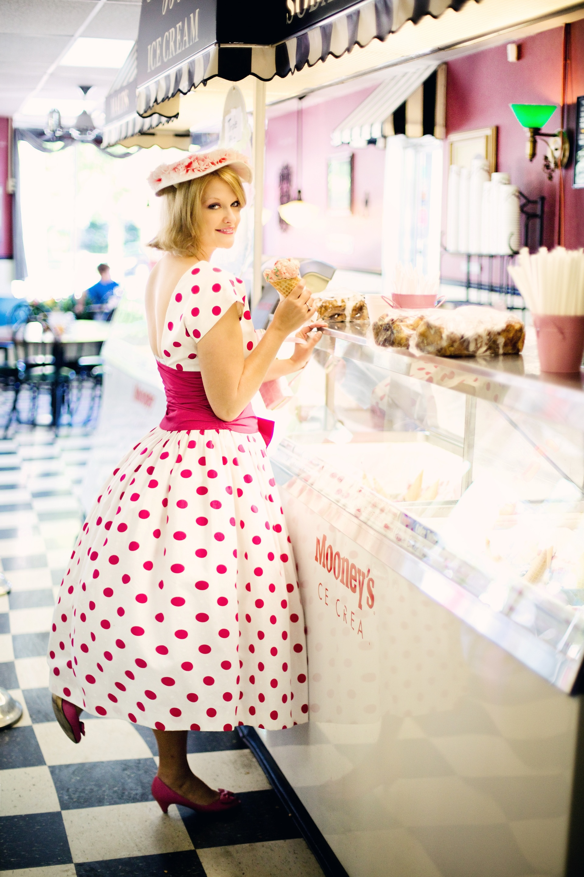 vintage-ice-cream-parlor-pretty-young-woman-vintage-polka-dot-dress-37647